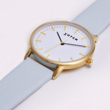 The Gold Face With Light Blue Strap