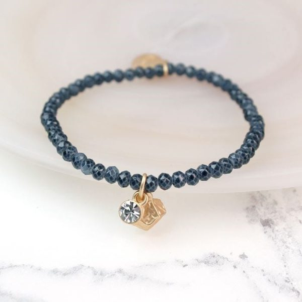 Crystal and Golden Charm Grey Bead Bracelet