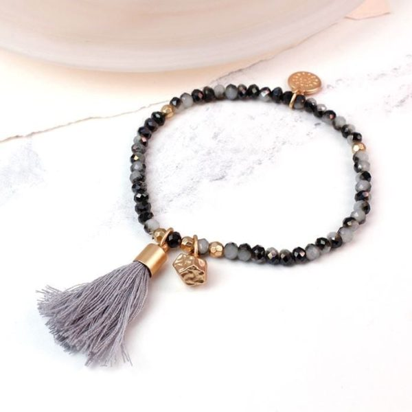 Golden Tassel and Charm Dark Crystal Bracelet