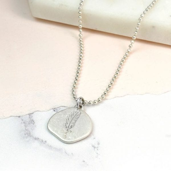 Silver Plated Feather Imprint Necklace with a Worn Finish